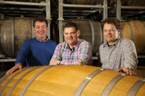 Brotherly love: Theo, Alex and Marcel in their cellar among Fuder barrels.