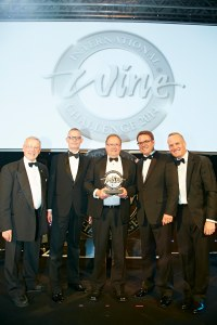 From left: Charles Metcalfe (IWC chairman), Markus Fellmann (global senior vice president, Hellmann Beverage Logistics), David Morris,  David Scace, (Global Director, Hellmann Beverage Logistics) and Tim Atkin MW (IWC Chairman).